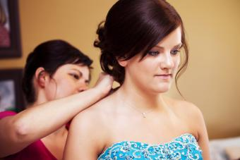 Mom helping daughter with prom necklace