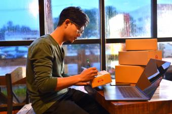 Teen packing boxes to mail