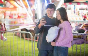 teenage couple texting