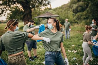 Group of volunteers cleaning nature together