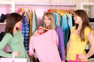 girls looking at clothes in a store