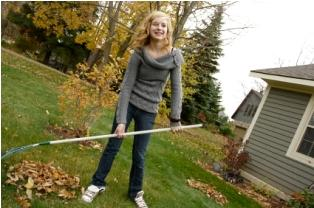 Teen raking leaves