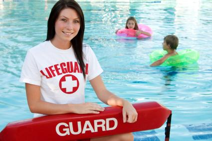 Teen working summer job as a lifeguard