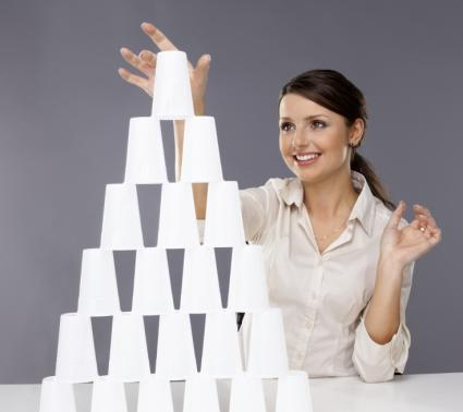 Girl building pyramid of cups