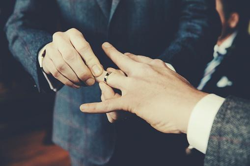 Men Exchanging Rings