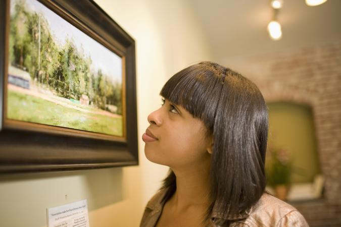 admiring painting in gallery