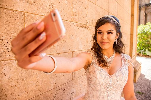 girl posing for cell phone selfie