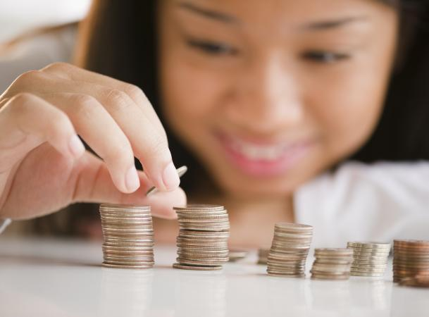 teenage girl stacking coins