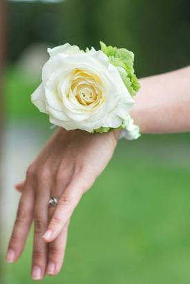 White rose corsage on woman's wrist