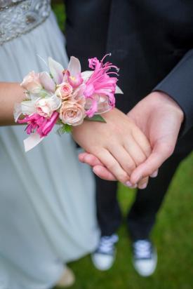 Girl wearing flower design wrist corsage