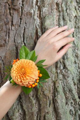 Orange flower and berries wrist corsage