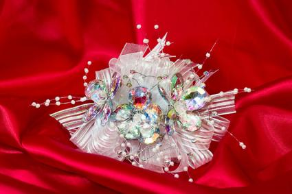 Crystal flowers corsage on red silk