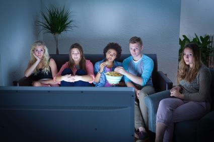 Teen friends watching TV together