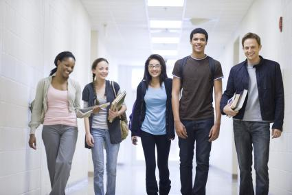 High school students walking down school corridor