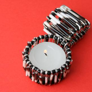 Safety pin candle holder