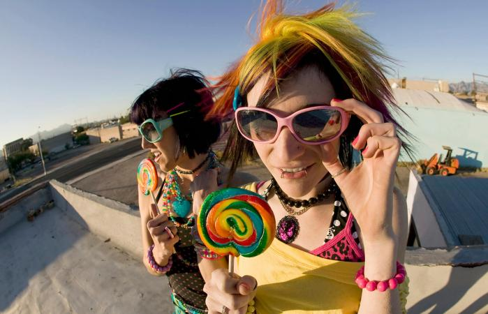 Fun girls on the roof with lollipops
