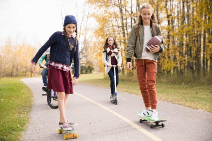Tween girls skateboarding
