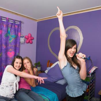 Teen girl dancing and singing