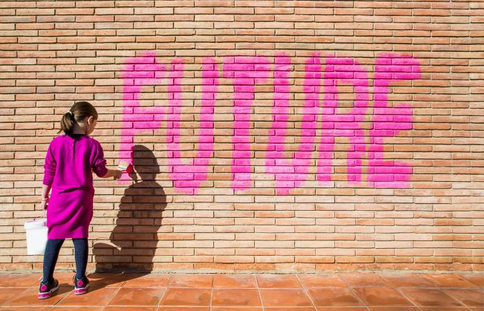 Girl painting the future word