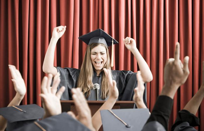 girl in cap and gown giving speech