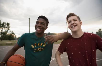 Teenage boys with basketball