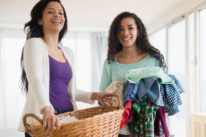 Mother and teen daughter doing laundry