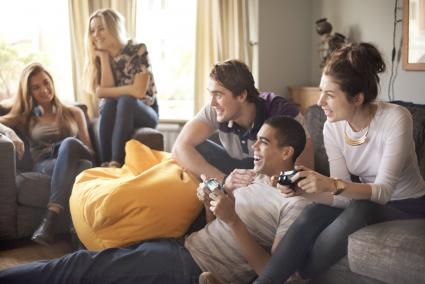 Teenagers playing video games