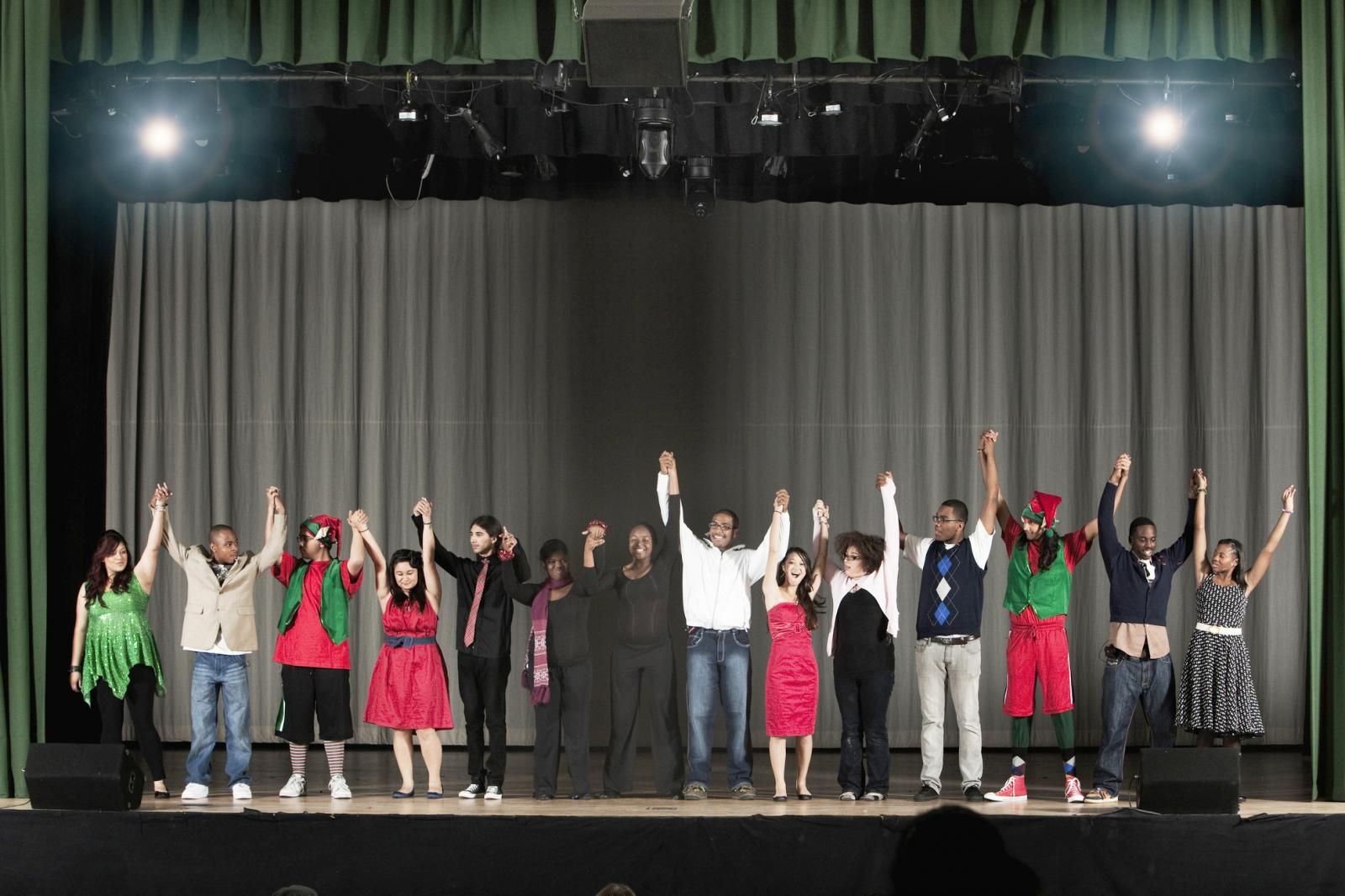 Students bowing on high school stage