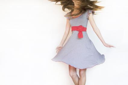 Girl in a dress spinning around