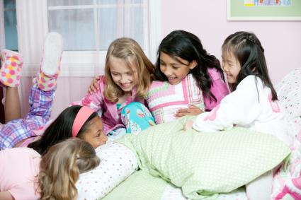 A diverse group of girls having a sleepover