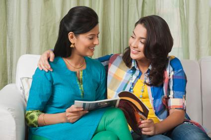 Girl sharing book with sister