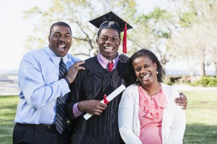 African American male graduate with parents