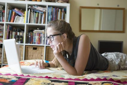 teen girl using laptop