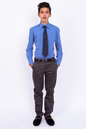 Teenage boy in blue shirt and tie
