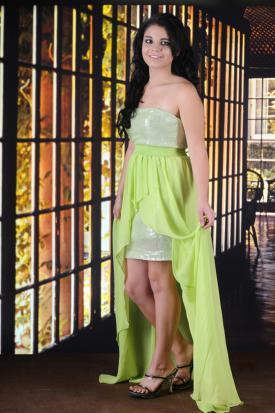 Teen girl in slim green gown