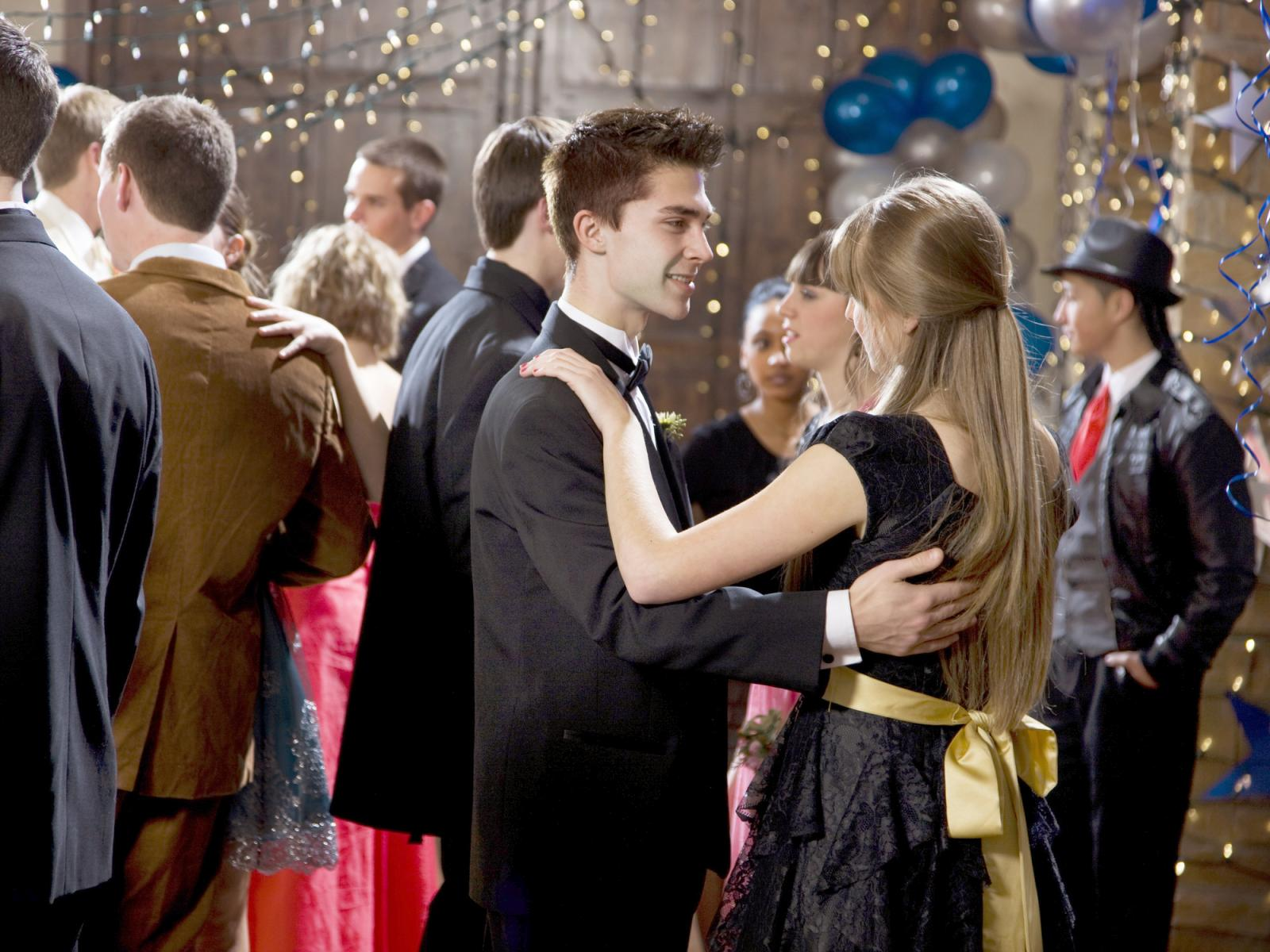 Teenage couples dancing at prom
