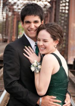 Couple laughing while taking prom pics