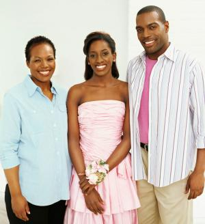 Teenage girl and her parents on prom night