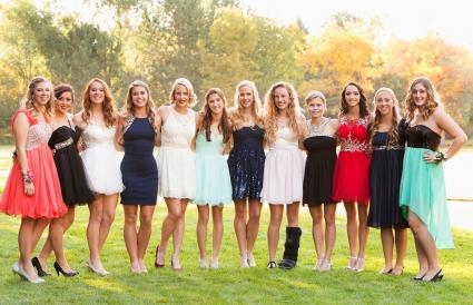 Teenage girls smiling before prom
