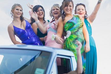 Girls waving from back of pickup