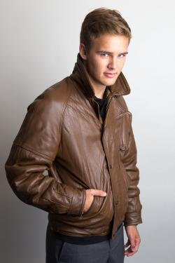 Boy in brown leather bomber jacket