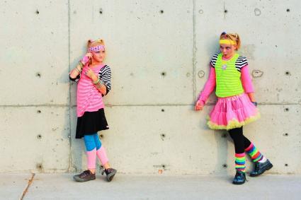 Girls wearing colorful leg warmers