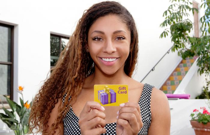 Teen holding gift cards