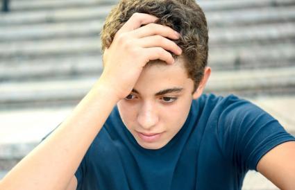 Posing pensive male teenager