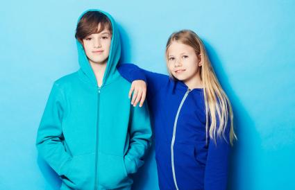 Boy and girl wearing hoodies