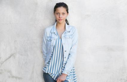 Young girl wearing denim jacket