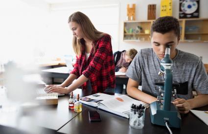 High school students doing chemistry homework