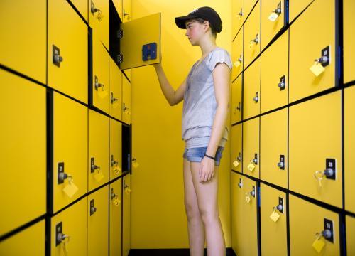 Teen opening a locker