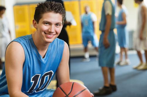 Teen basketball player in locker room