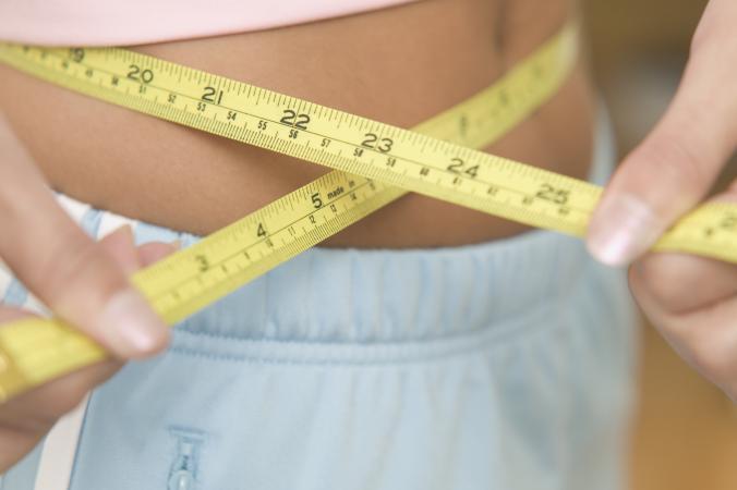Using tape measure around waist